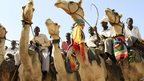 Men on camels in Darfur, Sudan - Tuesday 18 June 2013