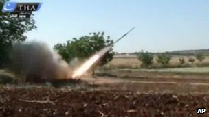 A rocket fired by Syrian rebels in Qusair, Syria, according to citizen journalists (May 28, 2013)