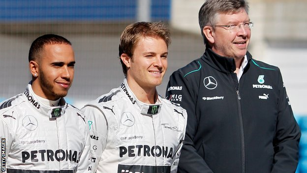 Lewis Hamilton (left), Nico Rosberg (centre) and Ross Brawn
