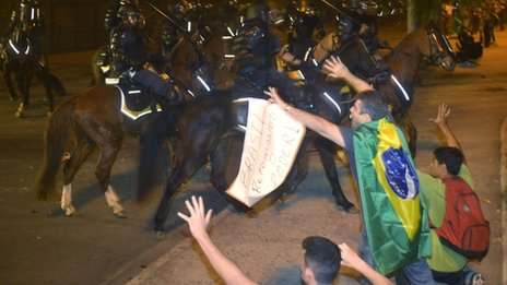 Protesters clash with mounted riot police in Rio de Janeiro. Photo: 20 June 2013