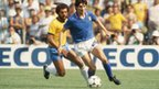 Paolo Rossi of Italy shields the ball from Junior of Brazil