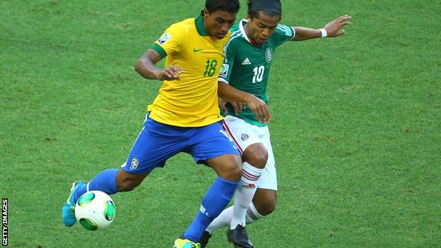 Paulinho (left) challenged by Mexico's former Spurs forward Giovani dos Santos