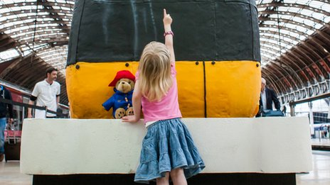Young girl with the train cake