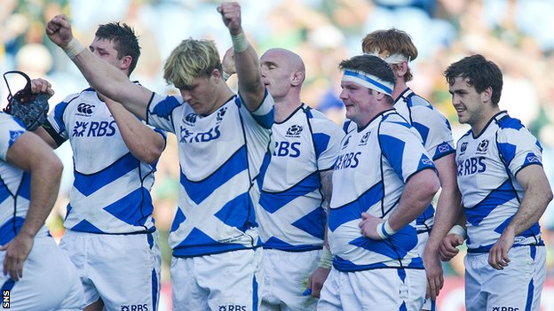 Exhausted Scotland players celebrate their 30-29 win over Italy