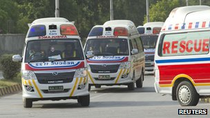 Ambulances carry the bodies of the foreign tourists (23 June 2013)