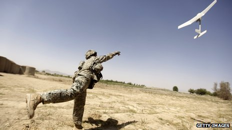 A US soldier tries to launch a small drone in Afghanistan