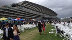 Royal Ascot racegoers mingle before the action gets under way