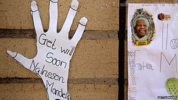 Children's get-well wishes are taped to the wall outside the Mediclinic Heart Hospital where Nelson Mandela is being treated on 22 June 2013