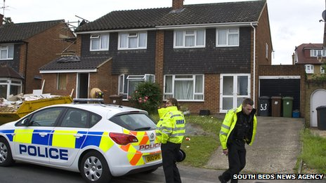 Police outside home (right) of Rebecca Thompson in Bushey, Herts