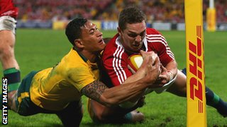 Israel Folau tackles George North to deny the Welshman a try on Saturday