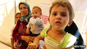 Syrian refugees wait for treatment at a Doctors of the World medical centre at the Al Zaatri refugee camp