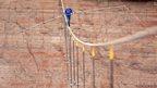 Man tightrope walks across US river gorge