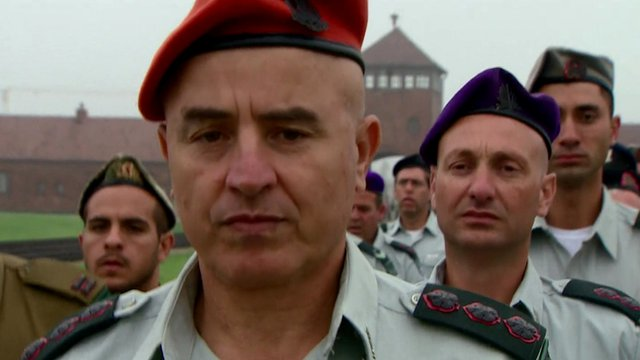 Israeli army officers march at Auschwitz