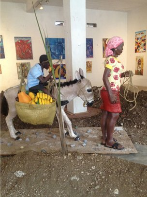 Two papier-mache figures displayed in Jacmel's art centre