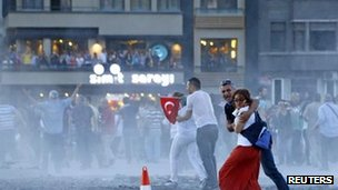 Riot police use water cannon in Taksim Square, 22 June