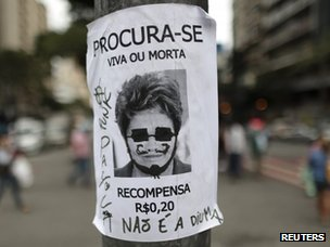 "A poster with an image of Dilma Rousseff saying: ""Wanted, dead or alive. Reward 0.20 reais"""