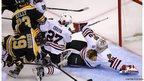 Chicago Blackhawks battle for position in Boston, Massachusetts