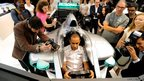 Lewis Hamilton in a formula one simulator