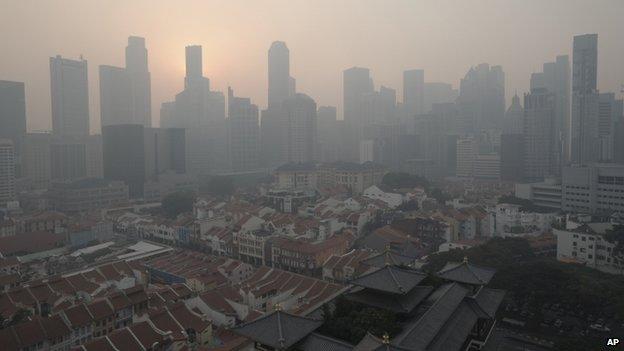 Singapore skyline under smog