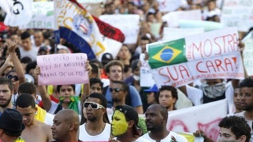 Demonstrators march near the Arena Fonte Nova stadium in Salvador, Brazil.