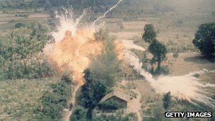 American napalm bombs exploding in fields south of Saigon during the Vietnam War
