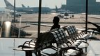 A passenger waits for his flight at Moscow's Sheremetyevo airport on Wednesday 26 June