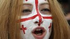 Woman with the Georgian flag painted on her face