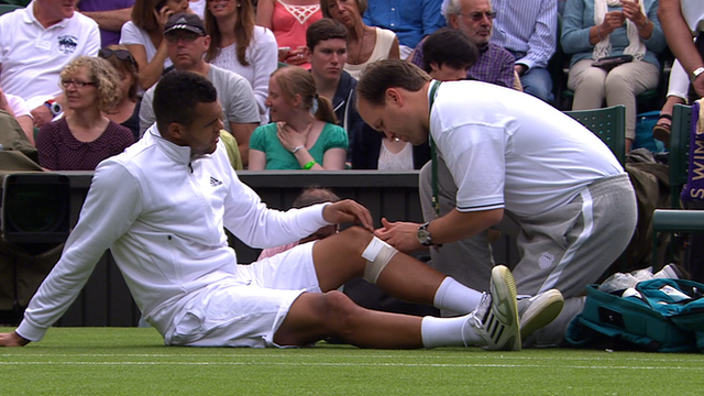 Tsonga receiving treatment
