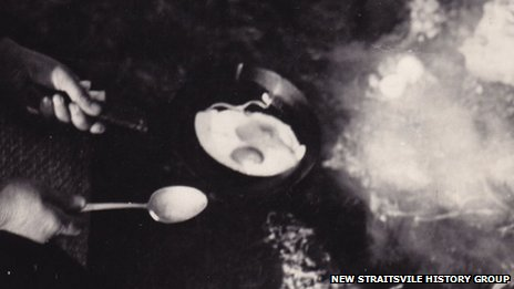 Someone frying an egg over a fire hole in New Straitsville, Ohio