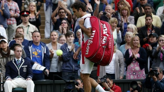 Roger Federer walks off court at Wimbledon 2013