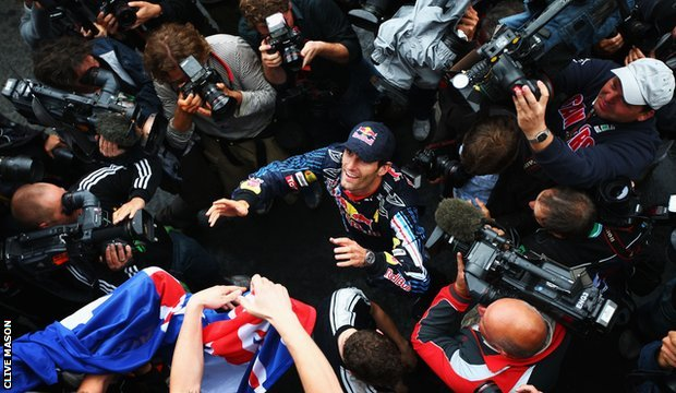 Mark Webber celebrates winning the 2009 German Grand Prix