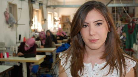 Tamara Arja in the Arja Textiles Company where women are making garments at sewing machines