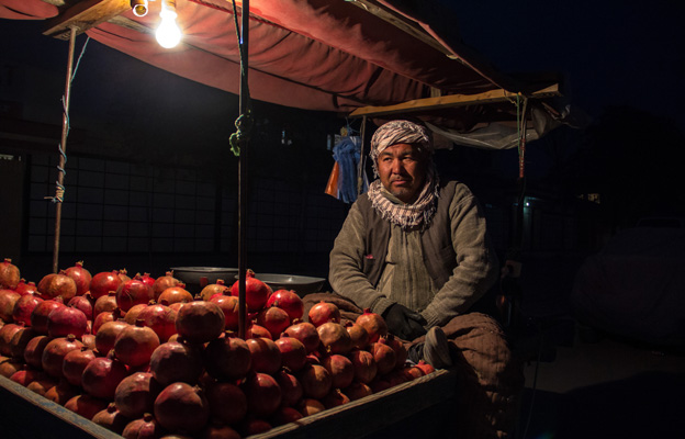 A man selling pomegranates