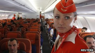 People onboard an Aeroflot Airbus A330 plane heading to the Cuban capital Havana at Moscow's Sheremetyevo airport on 27 June 2013