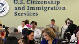 Immigrants await their turn for green card and citizenship interviews at the US Citizenship and Immigration Services (USCIS) office in Queens, New York City 30 May 2013