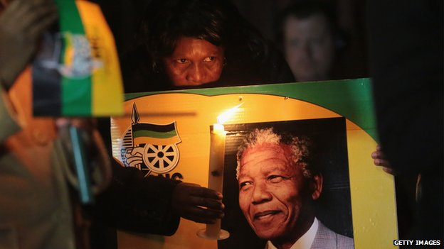 ANC supporters hold a candlelit vigil outside the former home of former South African President Nelson Mandela in Soweto township on June 27, 2013