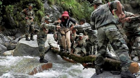 Army soldiers rescue a woman at Pindari Glacier, in Uttarakhand, on June 27, 2013