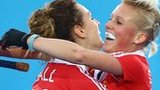 Alex Danson (R) of England celebrates her goal