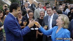 President Mikhail Saakashvili enjoys a toast with US Secretary of State Hilary Clinton