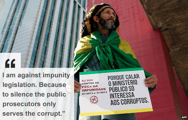 Sao Paulo protester holds banner against  PEC 37 -  a constitutional amendment which would limit the power of federal prosecutors to investigate crimes Sao Paulo, Brazil on 22 June