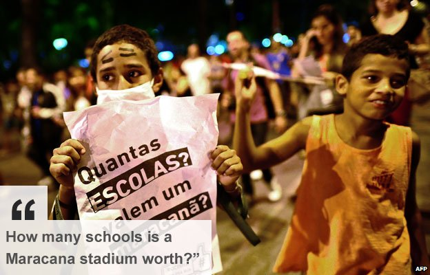 Residents of the Rocinha favela in Rio de Janeiro demonstrate against funding for World Cup stadiums 25 June