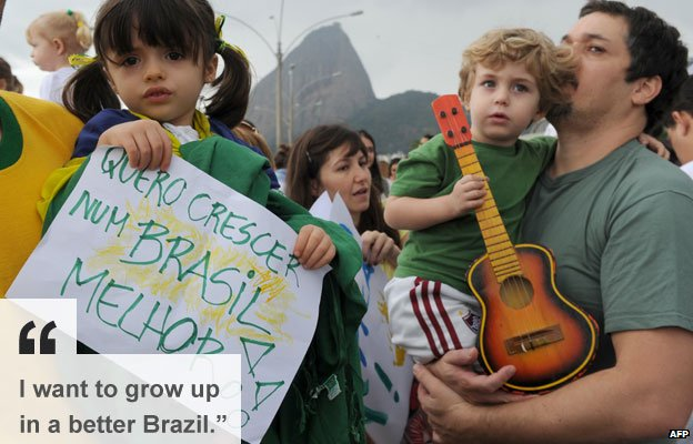 Children participate in a demonstration supporting democracy and protesting against police violence on 23 June in Rio de Janeiro,