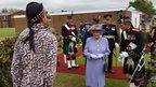 Lt Alan Garrett stands to attention in his Union Jack Onesie as the Queen looks on
