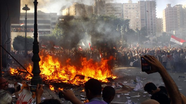 Opponents of Egyptian President Mohamed Morsi burn the content of a Freedom and Justice Party office in the coastal city of Alexandria on June 28, 2013