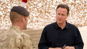 David Cameron talking to a soldier