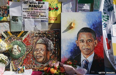 Portraits of Nelson Mandela (left) and Barack Obama outside the MediClinic Heart hospital in Pretoria, 29 June