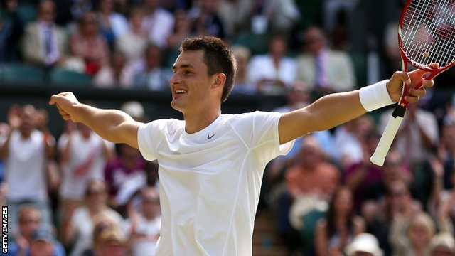 Bernard Tomic celebrates his victory over Richard Gasquet
