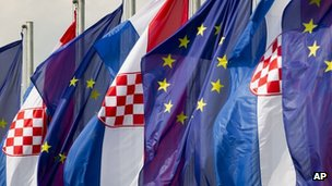 Croatian and the EU flags flutter at a road junction in Zagreb, Croatia, on Saturday