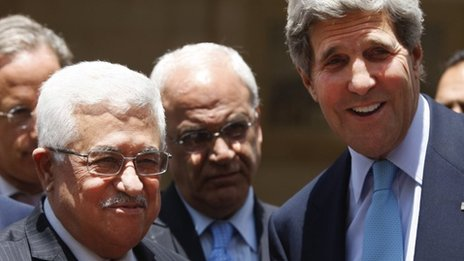 US Secretary of State John Kerry, right, and Palestinian President Mahmoud Abbas brief the media after their meeting in the West Bank city of Ramallah on Sunday