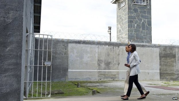 President Barack Obama and First Lady Michelle Obama in a prison yard at Robben Island, 30 June 2013